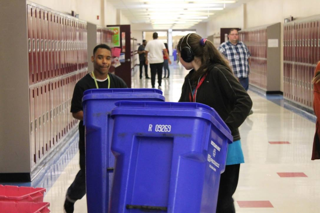 Parks' students participate in recycling volunteering.
