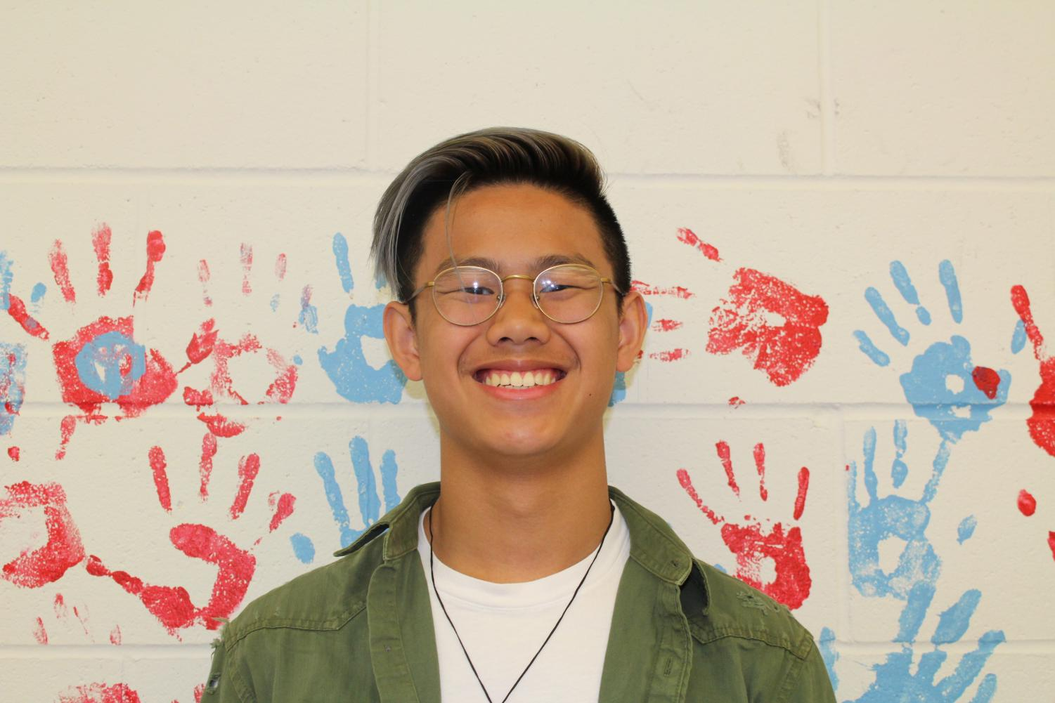 Austin Peng hangs out by the hand wall. Peng discussed his views on the walkout that occurred.
