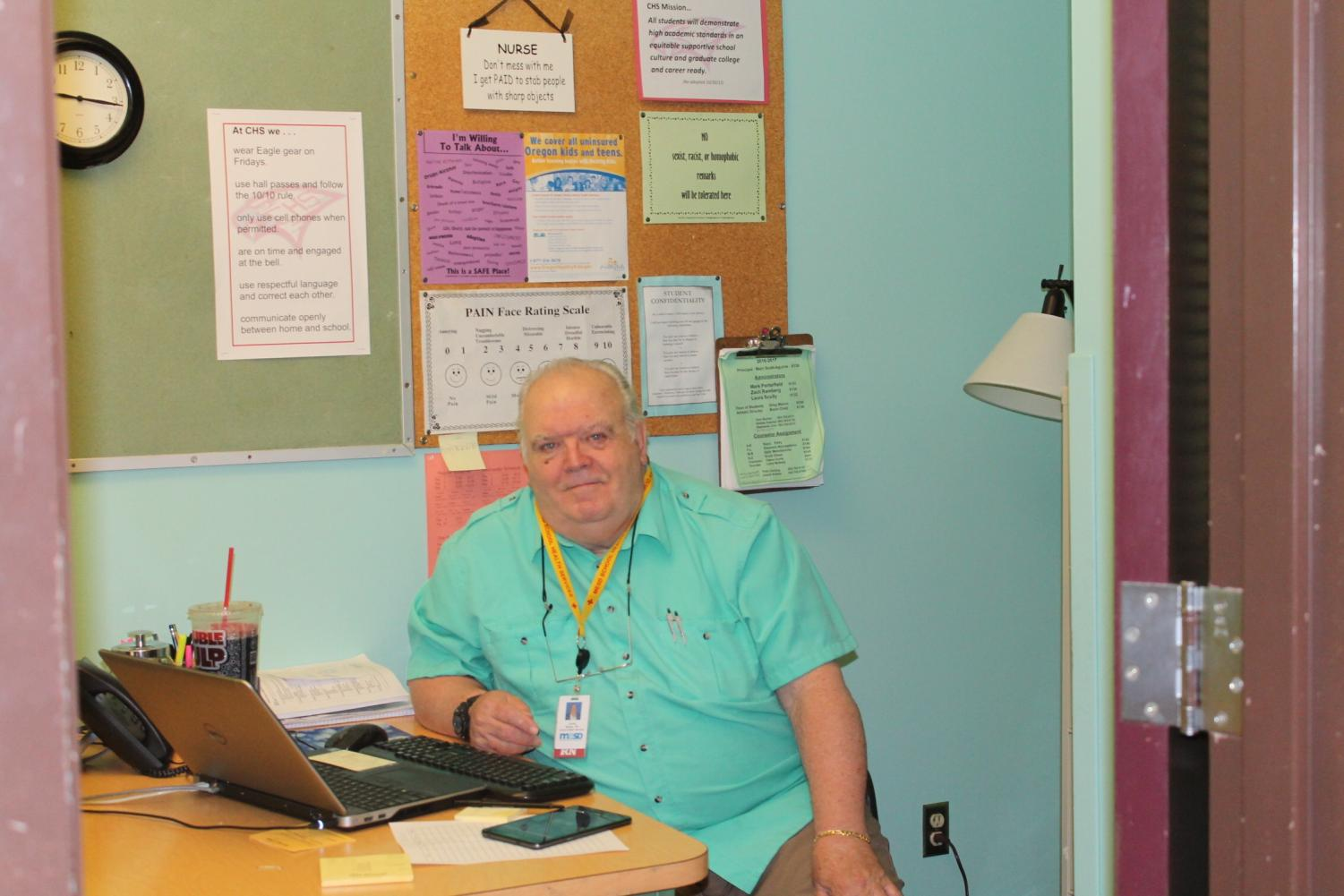 Gerry Milligan works at his desk. Milligan has enjoyed his time here so far.