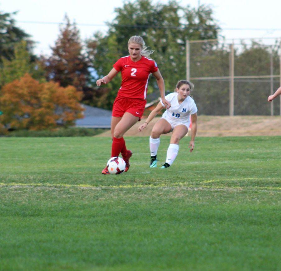 Chloe Smith runs across the field with the ball. The girls soccer team plays Sandy at 7 on Thursday.