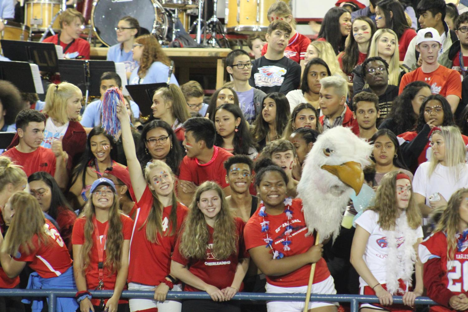 Students cheer in the stands at Homecoming. The football team heads to McMinnville for Friday's game.