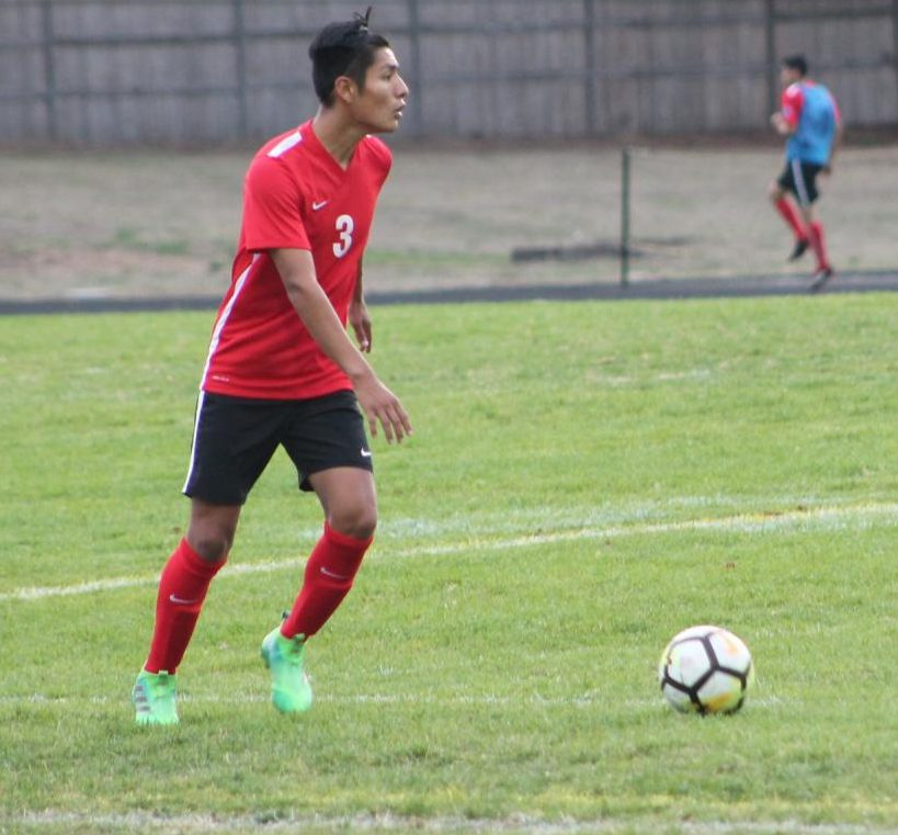Kevin Vasquez, number 3, passes the ball across the field. The Eagles ended the season with a final score of 3-2.