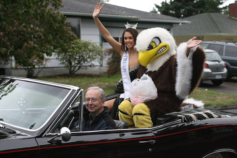 Miss Oregon Allison Cook rides with Elmer the Eagle during the Homecoming parade.