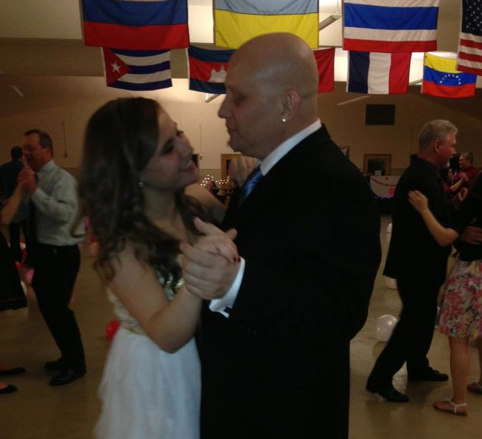 Lacey St. John dances with her father Schooner, who passed away due to complications with Lymphoma on Oct. 1.