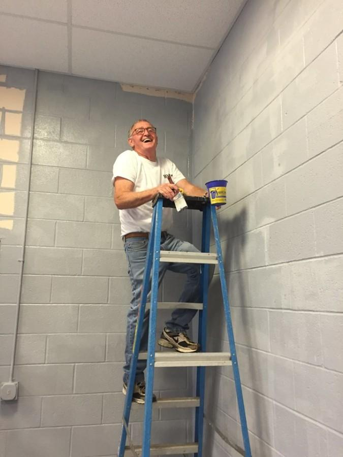 Abundant Life Church member, Phil Burke, paints auditorium.