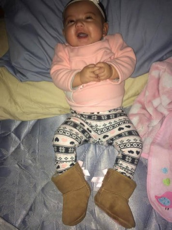 Baby Tessa, Lauren's little girl enjoying her new Uggs!