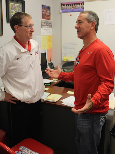 Football Coach Chris Knudsen and Athletic Director Brent Child meet earlier in the year.
