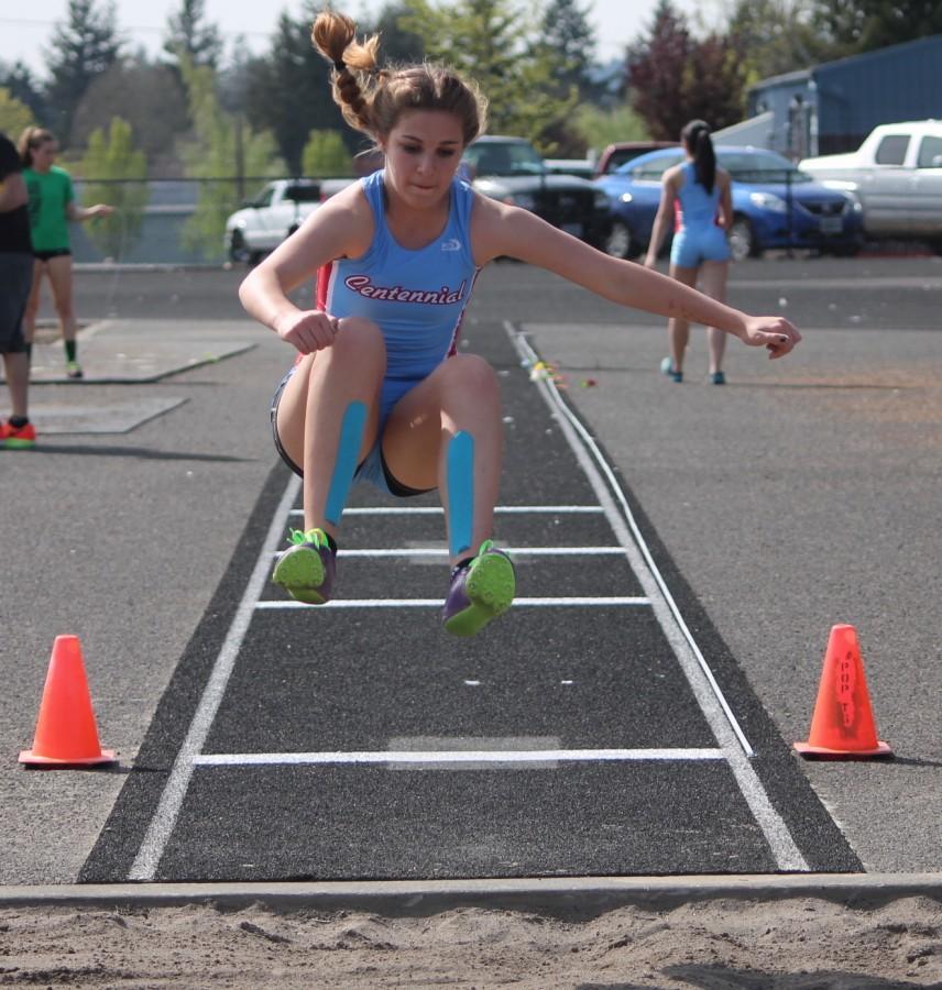 Emily Spain long jumps.