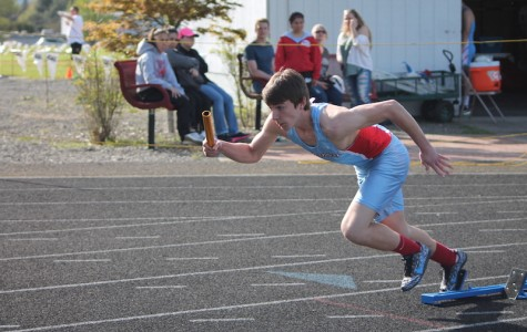 Jared Bierbauer explodes out of the starting blocks as the first leg in the 4x100 meter relay.