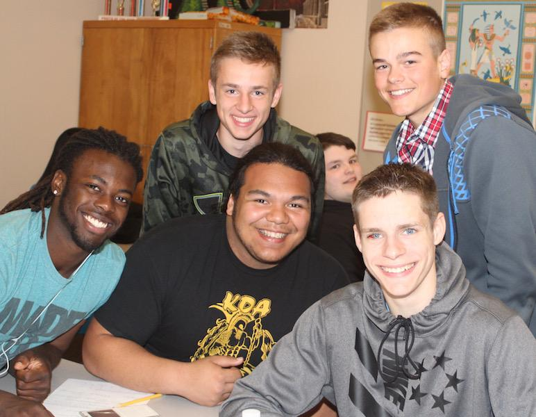 (Back) Nick Henry, Preston Degeneres, (Front) Jesse Porter, and Adam Bounphisay smile with Kole Snuggerud.