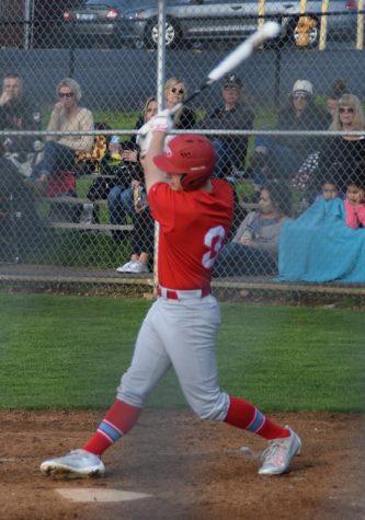 Junior Dawson Day follows through with his swing