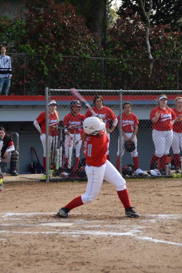 Hadley Cook follows through with her swing.
