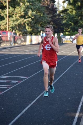 Cole Melvin sprints on the straightaway to finish his race.
