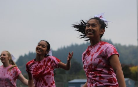 Dance team smiles during their routine in the outdoor assembly.