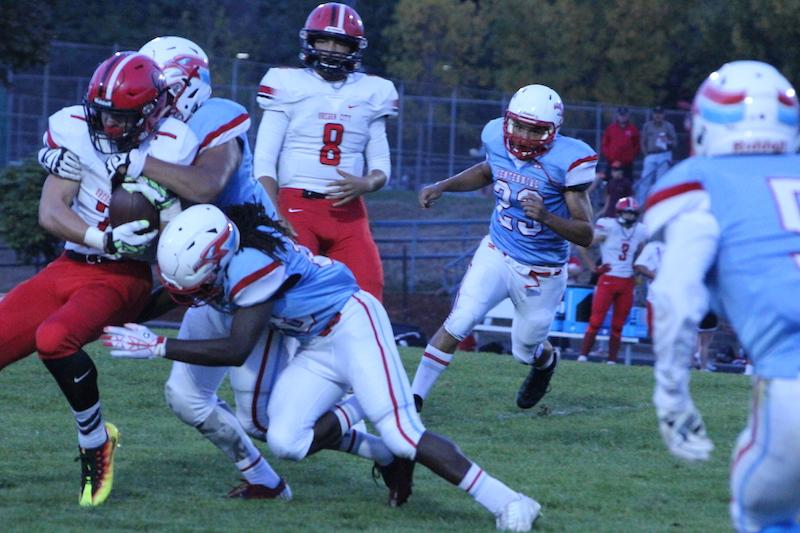 Jesse Porter tackling Oregon City running back.