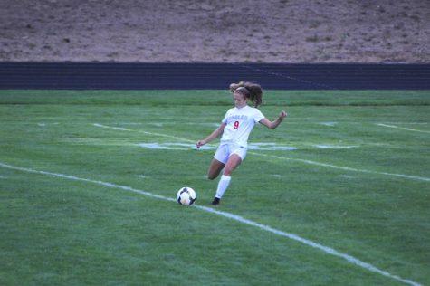Alyssa Ronnfeldt kicks the ball to her warm up partner.