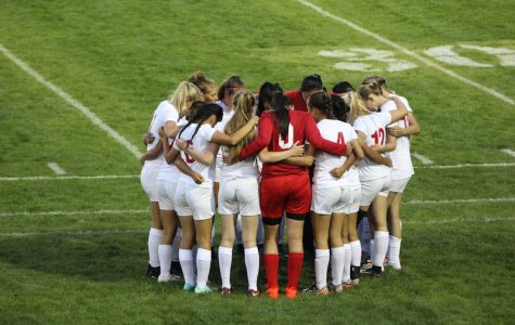 The team huddles before the game starts.