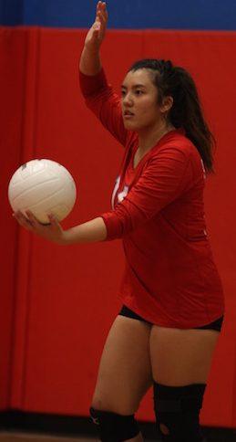 Erika Zuel serves the ball.