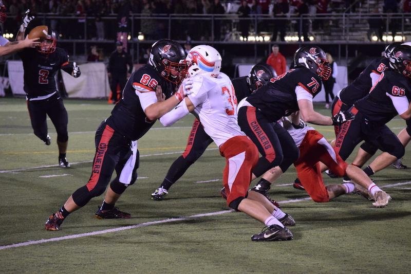Lineback Jadon Pickles shed Clackamas Tight End Chad Bletko in last Friday's 69-29 loss. The Eagles could face the Cavaliers next Friday if things go as expected in the first-round of the playoffs.