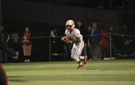 Senior Louis Salazar nearly broke this kickoff return for a touchdown last Friday at Clackamas.  Salazar had three receiving touchdowns as the Eagles lost 63-42 in the second-round of the playoffs.