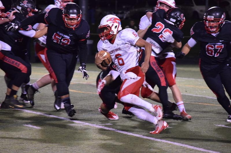 Quarterback Mychael Kane scrambles through the Clackamas defense last Friday.