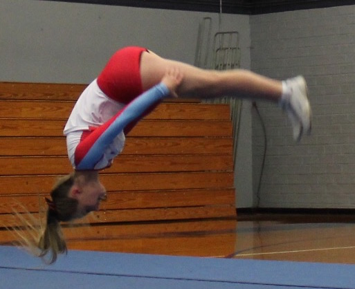 Abe Ede backflips during a cheer competition last Saturday.