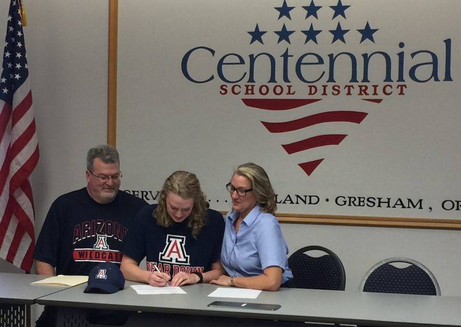 Senior Jamie Stone signed a letter of intent to swim for the Arizona Wildcats yesterday at the District Office.
