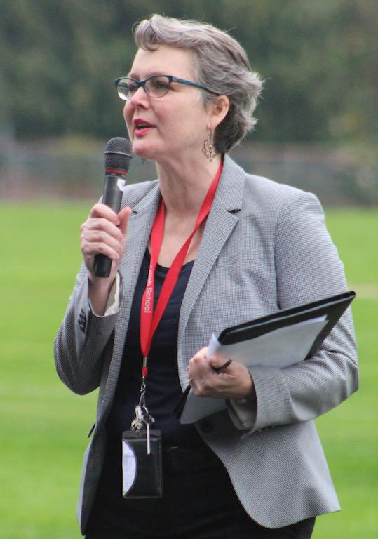 Mairi Scott-Agguire speaks at an outdoor assembly.