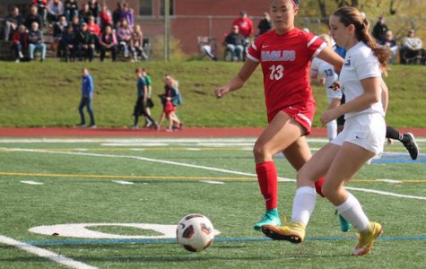 Senior Lani Saechin defends Grant outside wing Ally Lee in last Saturdays 4-1 playoff game.
