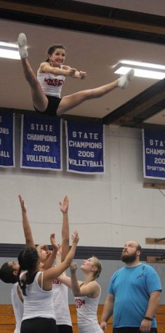 The team basket tosses sophomore Jade Wilson at Gresham competition last Saturday.