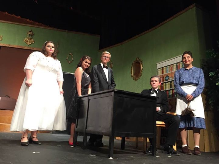 Cast members pose for a photo at final dress rehearsal.
