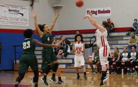 Senior Megan Byram fires a three against Wilson.