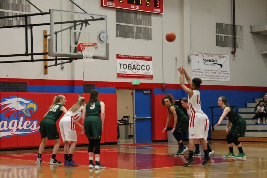 Senior Gianna Loville attempts a free-throw in Centennials opener.