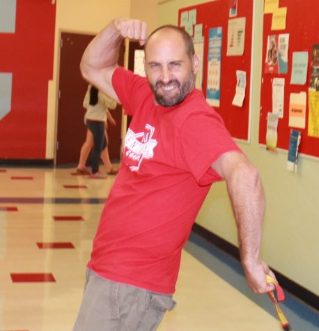 Ehren Schneider shows off his muscles in the hall, beforet he first day of school.