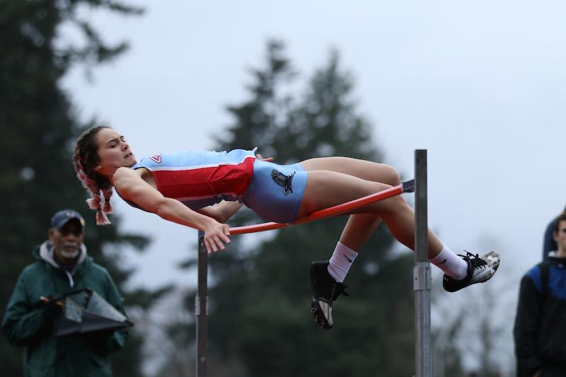 Sophomore Maddie Mchone high jumps against Newberg last week.