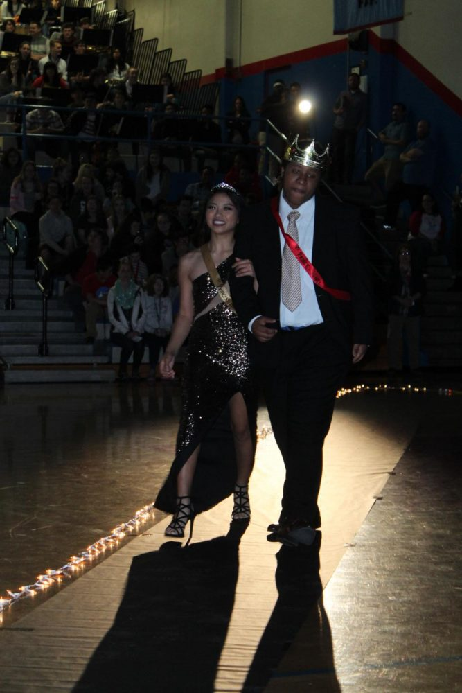 Princess+Brittney+Pioquinto+is+escorted+by+prince+Junel+Jeannis-Ostin.++This+years+prom+attendance+was+affected.