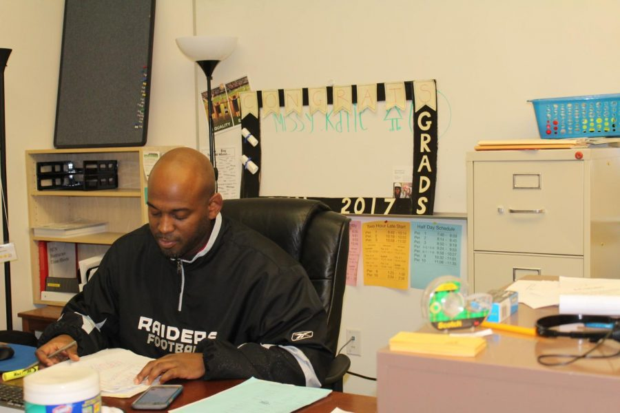 Damein+Roache+sits+at+his+desk+doing+some+paperwork.++SUN+offeres+new+after+school+opportunities+for+students.++
