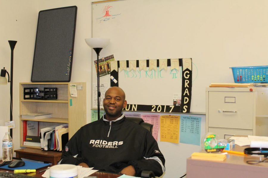 Damein Roache works at his desk. Roache is excited about the current sun courses that are available.