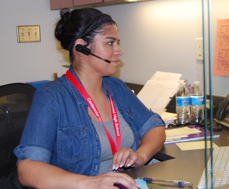 Maria Martinez works at her desk. Martinez started working at Centennial on Monday, April 23.