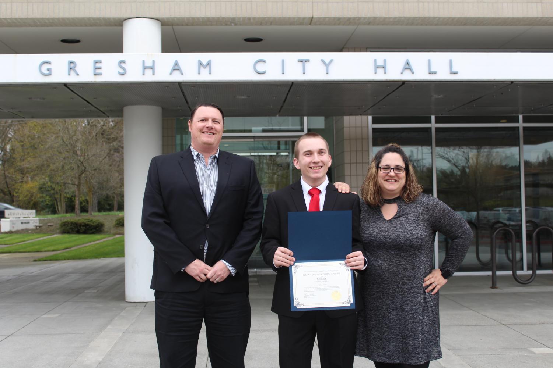Assistant Principle Zachary Ramberg, Brian Koll and Adriann Hardin. Koll won the Young Citizen Award.