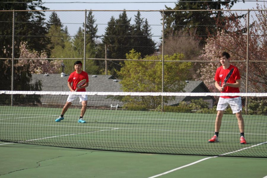 Kris Tran and Jaden Price ready for an incoming serve.