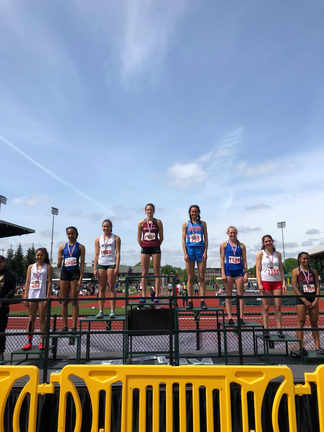 Junior Madison McHone, fifth from right to left, stands on the awards platform after one of her second place finishes last weekend.
