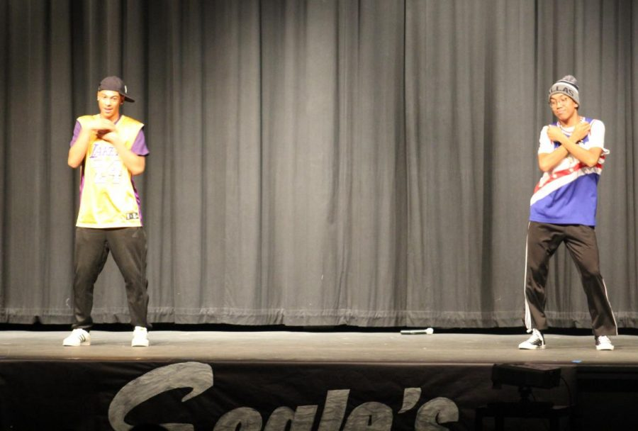 Dancing Queens, Jason DeLeon and Joaquin Madrigal dance at the talent show.