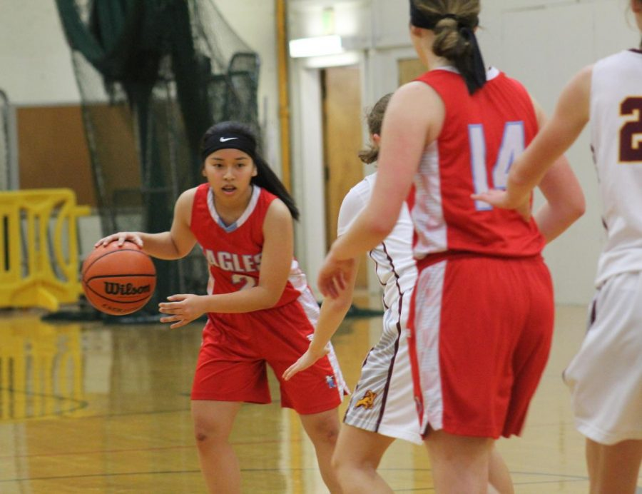 Freshman Quynh Vu enters a pass to sophomore Ellie Greene in last night's JV game at Central Catholic.