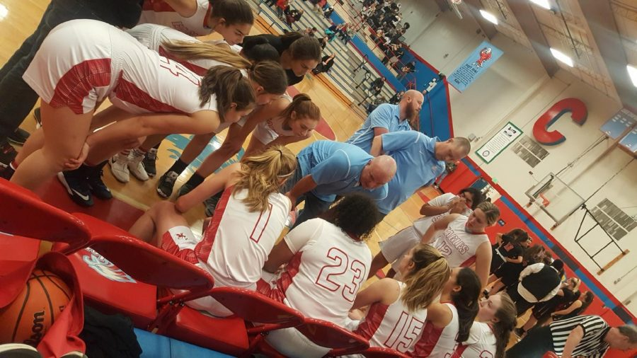 The+girls+basketball+team+huddles+before+two+crucial+free+throws+with+1.5+seconds+left+in+the+game+Tuesday.+The+Eagles+beat+Clackamas+for+the+first+time+in+30+years+Tuesday+night.