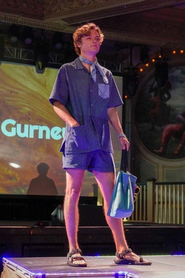 Mrs.Gurneys son John walks the runway in her clothing design.