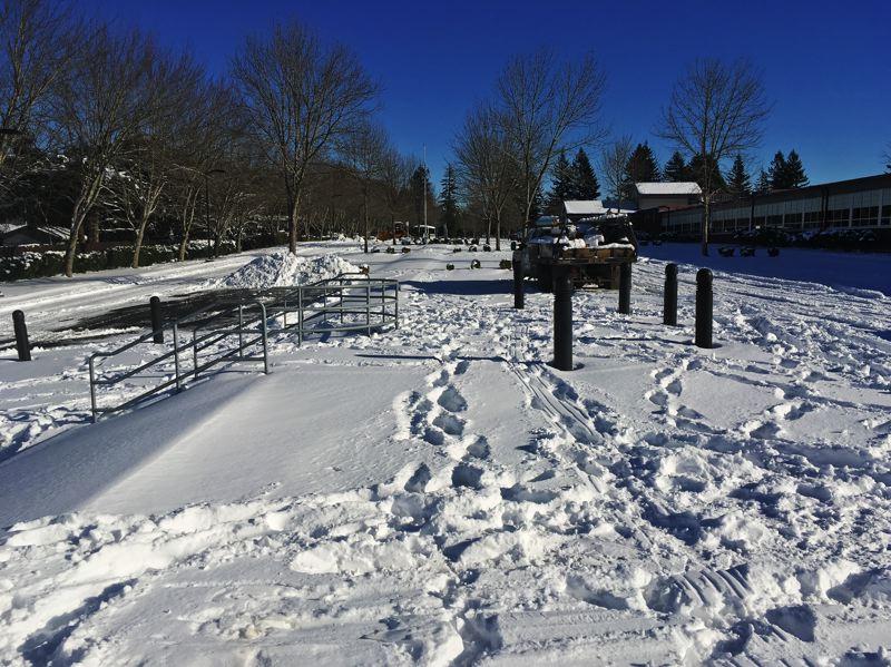 Snow+covers+the+Centennial+High+School+parking+lot.