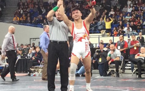 Phillip Kue wins his third state wrestling championship.