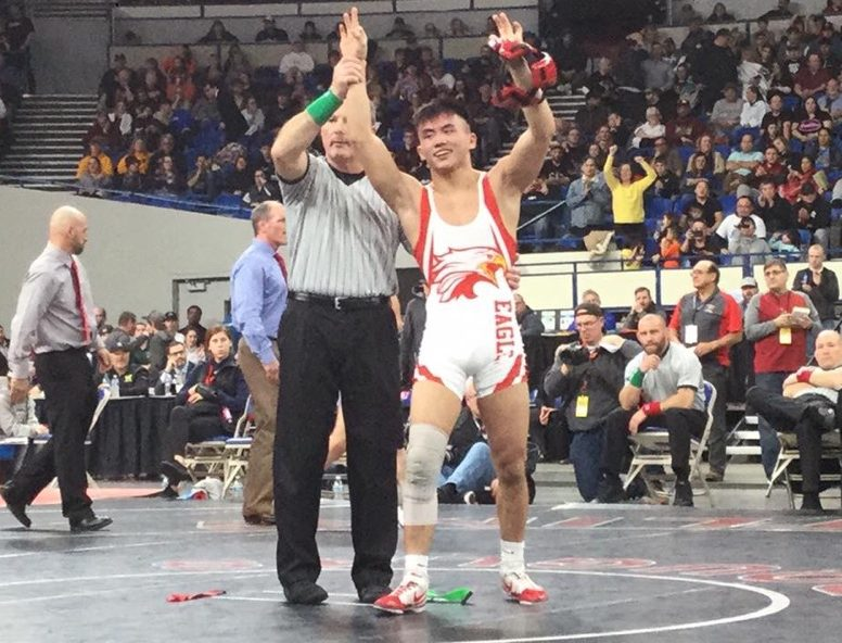 Phillip Kue wins his third state wrestling championship.
