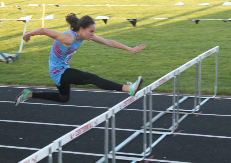 Maddie McHone competes in the high hurdles at the 55th Annual Centennial Invitational.